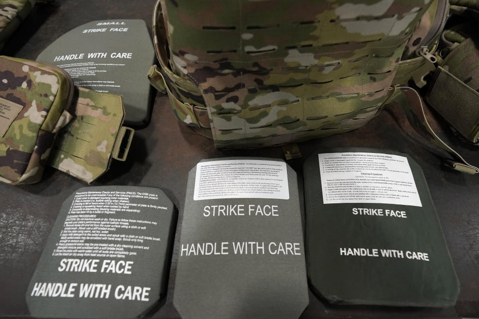 """Components of the new generation of the """"modular scalable vest"""" including various sized ceramic plates are shown while members of the 82nd Airborne Division are issued the new body armor at Fort Bragg, N.C., Wednesday, Sept. 22, 2021. The Army for the first time, began handing out armor that now comes in three additional sizes, and can be adjusted in multiple ways to fit better and allow soldiers to move faster and more freely. The so-called """"modular, scalable vest"""" was is being distributed to soldiers at Fort Bragg, N.C., along with new versions of the combat shirt that are tailored to better fit women, with shorter sleeves and a flare at the bottom where it hits their hips. (AP Photo/Gerry Broome)"""