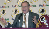 """FILE - In this Jan. 4, 2001, file photo, Washington Redskin's new head coach Marty Schottenheimer speaks at a news conference at Redskins Park in Ashburn, Va. Marty Schottenheimer, who won 200 regular-season games with four NFL teams thanks to his """"Martyball"""" brand of smash-mouth football but regularly fell short in the playoffs, has died. He was 77. Schottenheimer died Monday night, Feb. 8, 2021, at a hospice in Charlotte, North Carolina, his family said through Bob Moore, former Kansas City Chiefs publicist. (AP Photo/Stephen J. Boitano, FIle)"""
