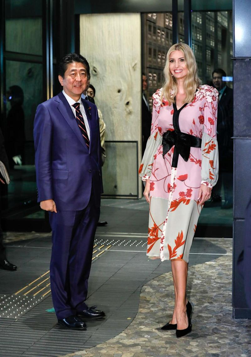 Later that evening, Ivanka joined Abe for dinner wearing a $2,600 pink, silk kimono-inspired dress with a black obi bow designed by Johanna Ortiz, with black pumps and her hair in beachy waves. Photo: Getty Images