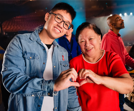 Calvin Tan, the youngest person in Singapore openly out about HIV positive status, and Iris Verghese, a pioneer HIV caregiver. (PHOTO: SidexSide Photography)