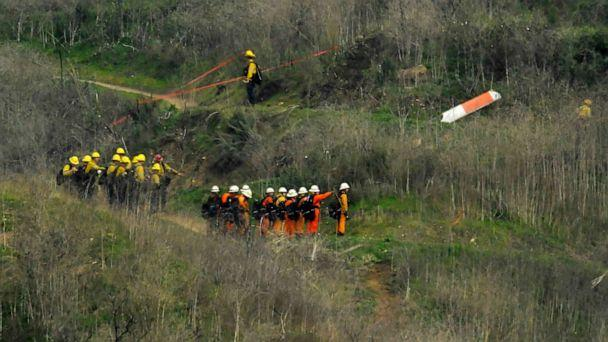 PHOTO: Firefighters work the scene of a helicopter crash where former NBA star Kobe Bryant died, Jan. 26, 2020, in Calabasas, Calif. (Mark J. Terrill/AP)