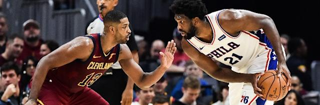Tristan Thompson of the Cleveland Cavaliers (left) defends Joel Embiid of the Philadelphia 76ers.