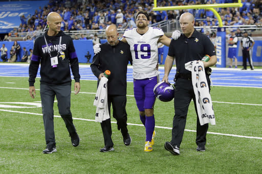 FILE - In this Oct. 20, 2019, file photo, Minnesota Vikings wide receiver Adam Thielen (19) is helped off the field during the first half of an NFL football game against the Detroit Lions, in Detroit. The Vikings have ruled wide receiver Adam Thielen out for the game at Dallas, on Sunday, Nov. 10, increasing the possibility the two-time Pro Bowl pick will rest for the remainder of the month to be safe with his hamstring injury.(AP Photo/Duane Burleson, File)