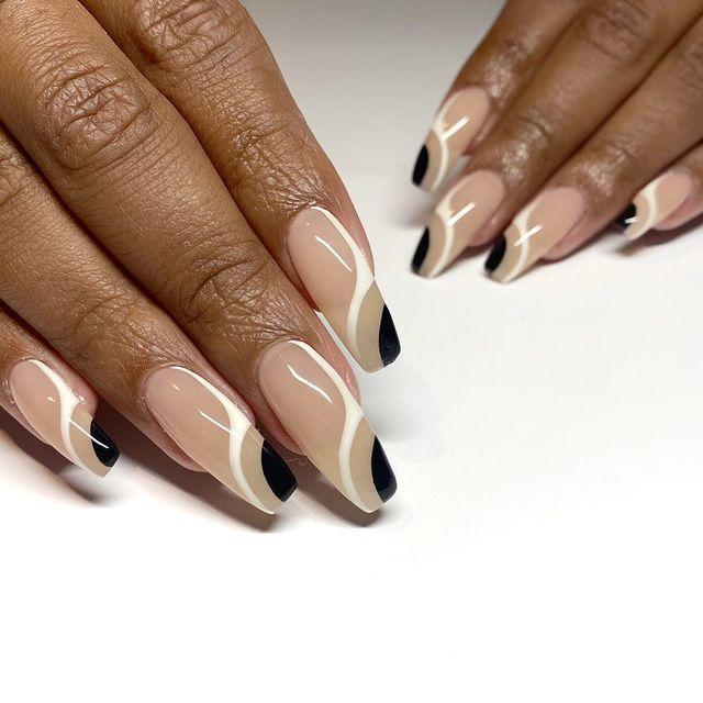 """<p>Combining opposite shades, like black and white, can <strong>create some really cool, balanced looks, even when the design is asymmetrical</strong>. Take the abstract shapes on these <a href=""""https://www.cosmopolitan.com/style-beauty/beauty/g26451517/ballerina-nails-shape-design/"""" rel=""""nofollow noopener"""" target=""""_blank"""" data-ylk=""""slk:ballerina nails"""" class=""""link rapid-noclick-resp"""">ballerina nails</a>, for instance.<br></p><p><a href=""""https://www.instagram.com/p/CIWHcA8h9OM/?utm_source=ig_embed&utm_campaign=loading"""" rel=""""nofollow noopener"""" target=""""_blank"""" data-ylk=""""slk:See the original post on Instagram"""" class=""""link rapid-noclick-resp"""">See the original post on Instagram</a></p>"""