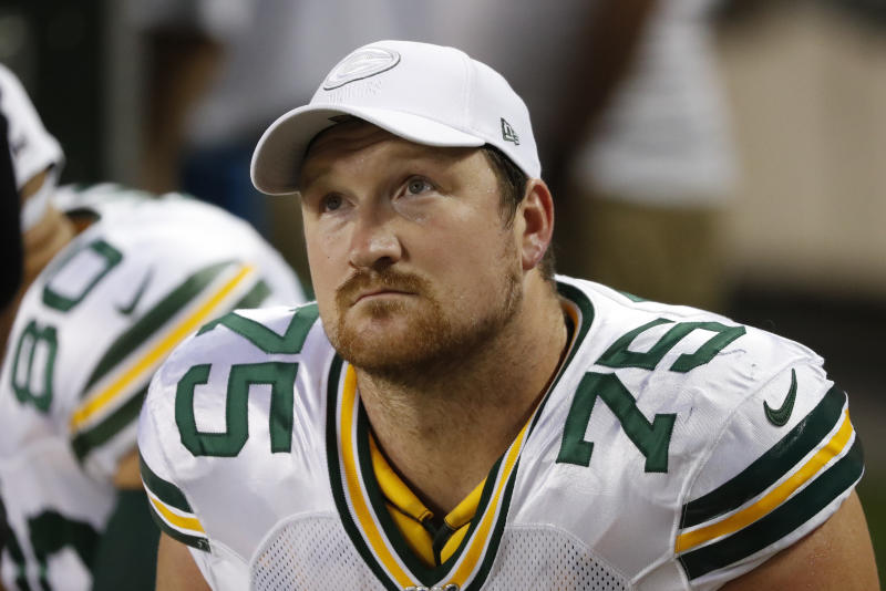 In this Sept. 5, 2019 file photo Green Bay Packers offensive tackle Bryan Bulaga sits on the bench during an NFL football game against the Chicago Bears in Chicago. By adding linebacker Christian Kirksey and offensive tackle Rick Wagner this week, the Packers signaled that they would be moving forward without two key veterans. That became apparent when longtime right tackle Bryan Bulaga agreed to terms with the Los Angeles Chargers. The Packers confirmed reports of his departure Wednesday, March 18, 2020 on the opening day of free agency. (AP Photo/Charles Rex Arbogast, file)