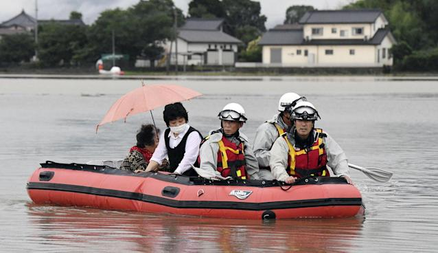 <p>Residents are rescued by boat after heavy rain isolated an area in Asakura, Fukuoka prefecture, southwestern Japan Thursday, July 6, 2017. Heavy rain following a recent typhoon flooded many houses in southwestern Japan, forcing thousands of people to flee, authorities said. (Photo: Sadayuki Goto/Kyodo News via AP) </p>