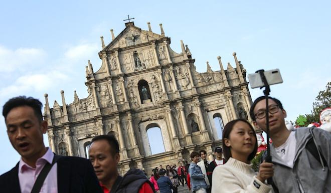 Tourists at the ruins of St Paul's in Macau. The city's tourism industry has taken a huge hit from the Covid-19 pandemic. Photo: Nora Tam