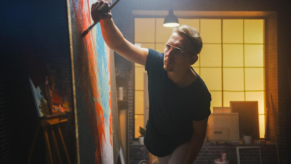 Talented Artist Working on Abstract Painting, Uses Paint Brush To Create Daringly Emotional Modern Picture.