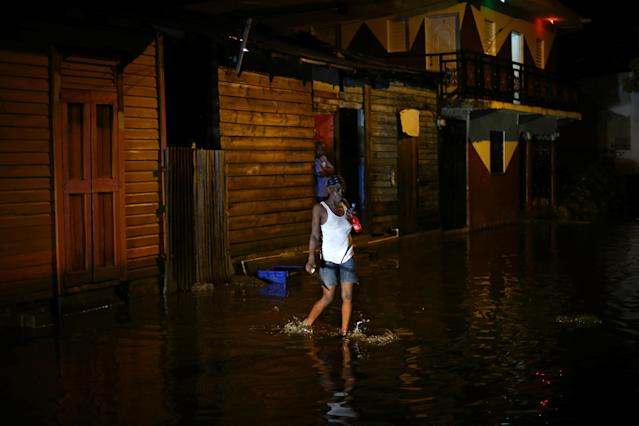 <p>A woman walks through a flooded street as Hurricane Irma moves off from the northern coast of the Dominican Republic, in Puerto Plata, Dominican Republic, Sept. 7, 2017. (Photo: Ivan Alvarado/Reuters) </p>