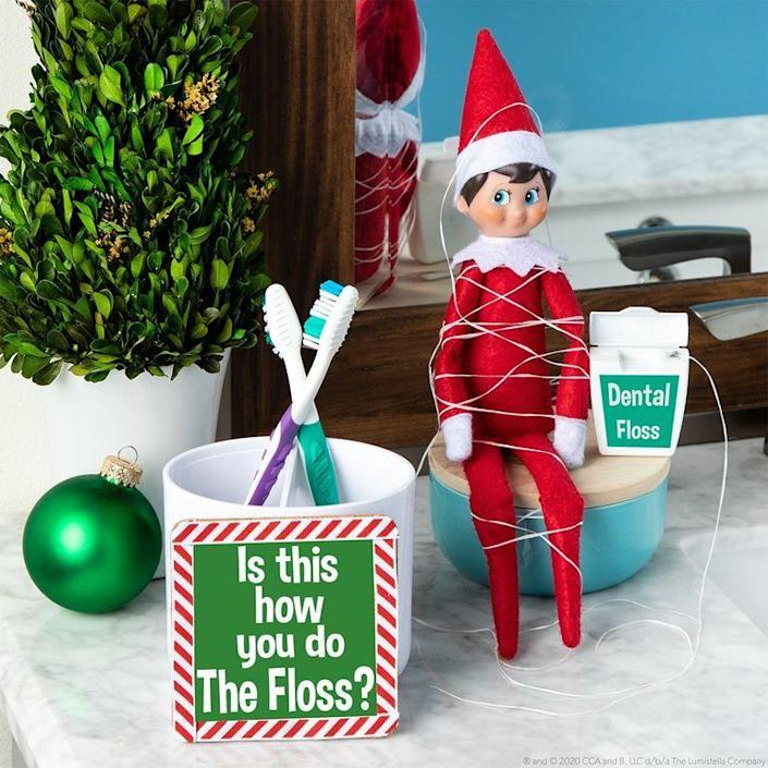"""<p>Wrap your Elf up in dental floss, then watch your kids faces light up when they find him in their bathroom in the morning. It's an easy way to repurpose an item you've already got in your house.</p><p><strong>Get the tutorial at <a href=""""https://elfontheshelf.com/elf-ideas/how-to-floss"""" rel=""""nofollow noopener"""" target=""""_blank"""" data-ylk=""""slk:The Elf on the Shelf"""" class=""""link rapid-noclick-resp"""">The Elf on the Shelf</a>.</strong></p><p><strong><a class=""""link rapid-noclick-resp"""" href=""""https://www.amazon.com/Elf-Shelf-Boy-Light/dp/B07TJJTBW8/?tag=syn-yahoo-20&ascsubtag=%5Bartid%7C2164.g.34080491%5Bsrc%7Cyahoo-us"""" rel=""""nofollow noopener"""" target=""""_blank"""" data-ylk=""""slk:SHOP ELF ON THE SHELF"""">SHOP ELF ON THE SHELF</a><br></strong></p>"""