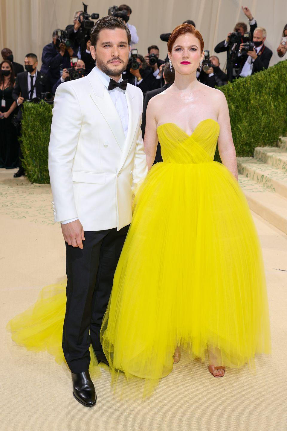 <p>Vigil's Rose Leslie wore a strapless canary yellow gown while husband Kit Harington wore a white tuxedo. </p>