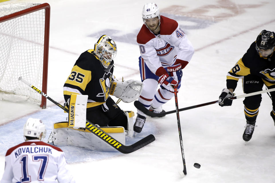 Montreal Canadiens' Joel Armia (40) can't get a shot off in front of Pittsburgh Penguins goaltender Tristan Jarry (35) with Kris Letang (58) defending during the first period of an NHL hockey game in Pittsburgh, Friday, Feb. 14, 2020. (AP Photo/Gene J. Puskar)