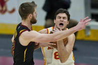 Atlanta Hawks' Danilo Gallinari, right, drives against Cleveland Cavaliers' Dean Wade in the second half of an NBA basketball game, Tuesday, Feb. 23, 2021, in Cleveland. (AP Photo/Tony Dejak)