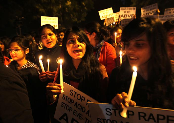 NEW DELHI, INDIA - DECEMBER 16: Akhil Bharatiya Vidyarthi Parishad (ABVP) activists take part in a candle march on the second anniversary of the fatal gang-rape at Jantar Mantar on December 16, 2014 in New Delhi, India. On December 16, 2012, a 23-year-old physiotherapy student was brutally gang raped and by six men, including a juvenile, in a moving bus. The incident unleashed a wave of public anger over levels of violence against women in the country. (Photo by Ajay Aggarwal/Hindustan Times via Getty Images)