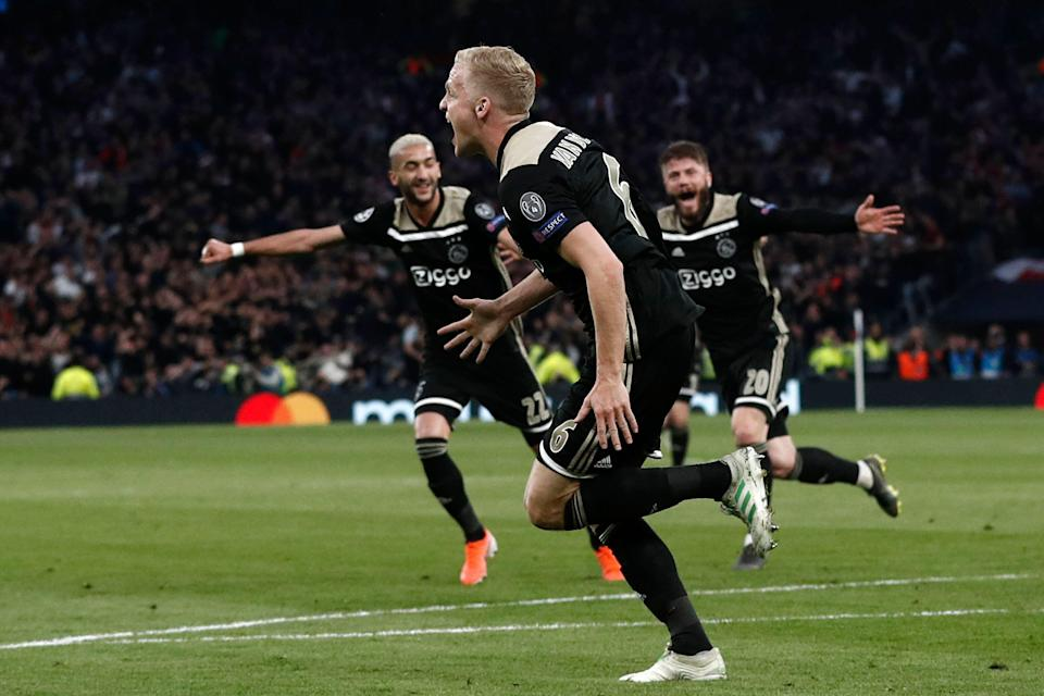 Ajax's Dutch midfielder Donny van de Beek (C) runs to celebrate with teammates after scoring the opening goal of the UEFA Champions League semi-final first leg football match between Tottenham Hotspur and Ajax at the Tottenham Hotspur Stadium in north London, on April 30, 2019. (Photo by Adrian DENNIS / AFP)        (Photo credit should read ADRIAN DENNIS/AFP/Getty Images)
