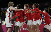 Japan's Maki Takada, left, celebrates with teammates after their win over Belgium in a women's basketball quarterfinal game at the 2020 Summer Olympics, Wednesday, Aug. 4, 2021, in Saitama, Japan. (AP Photo/Eric Gay)