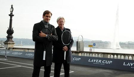 Switzerland's Roger Federer and Bjorn Borg (R) of Sweden pose after a tennis session to promote the Laver Cup tennis tournament on a temporary court on the banks of Lake Geneva in Geneva, Switzerland February 8,2019. REUTERS/Arnd Wiegmann
