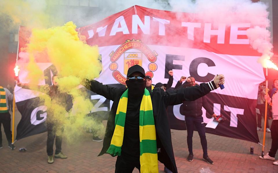 There were huge protests outside Old Trafford after the European Super League plans were announced - GETTY IMAGES