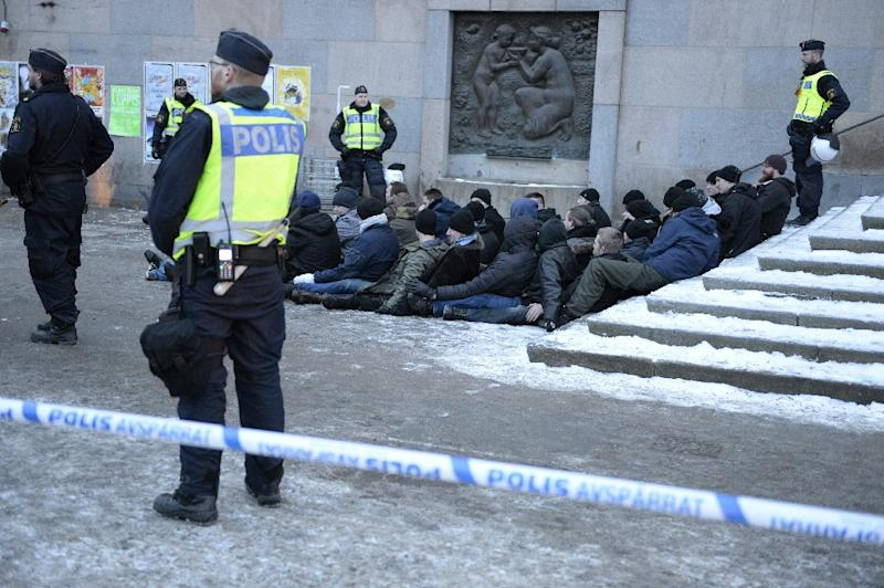 Swedish police surround an arrested group of neo-Nazis after they staged a rally in Stockholm in January (AFP Photo/Jessica Gow)