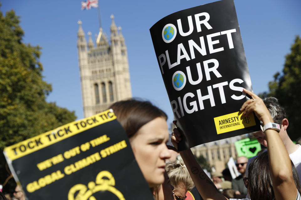 A climate protester holds up her placard as she takes part in a demonstration near Parliament square in London, Friday, Sept. 20, 2019. (Photo: Alastair Grant/AP)