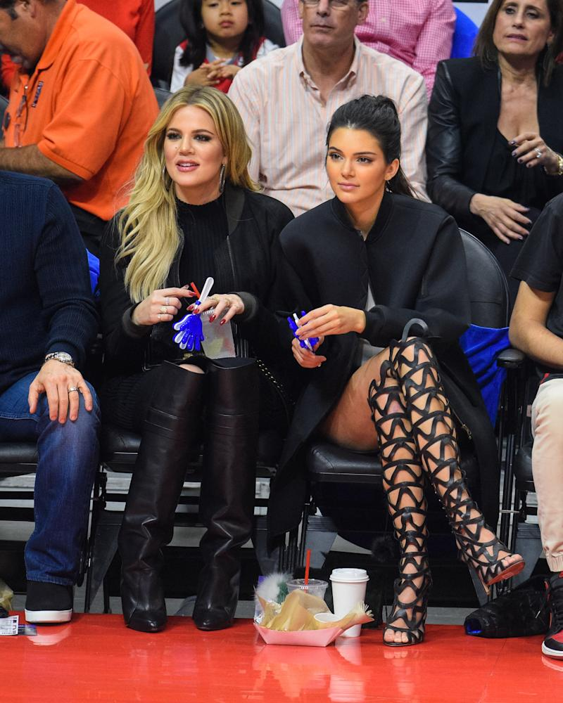 Kendall Jenner wore a somewhat more understated ensemble, with entirely more outrageous shoes, while attending a basketball game between the Houston Rockets and The Los Angeles Clippers with her sister Khloe Kardashian.