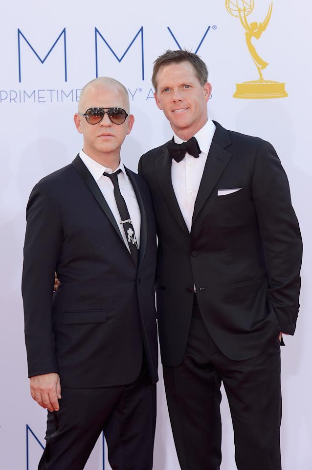 LOS ANGELES, CA - SEPTEMBER 23:  Producer Ryan Murphy (L) and guest arrive at the 64th Annual Primetime Emmy Awards at Nokia Theatre L.A. Live on September 23, 2012 in Los Angeles, California.  (Photo by Kevork Djansezian/Getty Images)