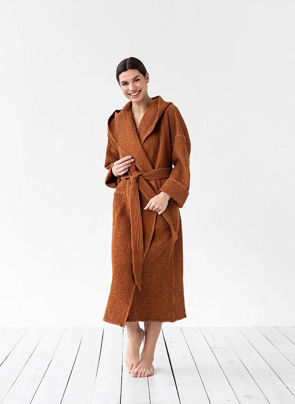 """<h3><h2>MagicLinen Linen Waffle Bathrobe</h2></h3><br>Simple waffle weave meets luxurious stone-washed linen and elopes in glamorous oversized fashion — and here's what the critics are saying: """"It is stunning! It fits perfectly. It is very elegant and comfortable. I highly recommend buying this robe.""""<br><br><strong>MagicLinen</strong> Stonewashed Linen Waffle Bathrobe, $, available at <a href=""""https://go.skimresources.com/?id=30283X879131&url=https%3A%2F%2Fwww.etsy.com%2Flisting%2F696119483%2Fwomens-waffle-linen-bath-robe-unisex"""" rel=""""nofollow noopener"""" target=""""_blank"""" data-ylk=""""slk:Etsy"""" class=""""link rapid-noclick-resp"""">Etsy</a>"""