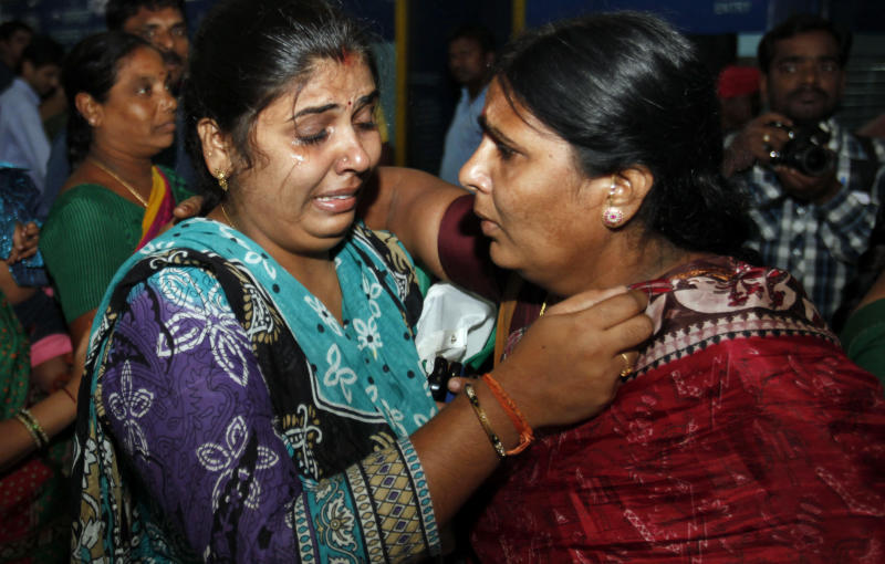 Indian pilgrim Ramadevi, right, who was stranded after flash floods and landslides in Uttarakhand state, hugs her relative on her arrival in Hyderabad, India, Tuesday, June 25, 2013. An air force helicopter returning from a rescue mission in flood-ravaged northern India hit the side of a mountain and fell into a river on Tuesday, killing eight people, officials said. Bad weather has hampered rescue efforts in Uttarakhand state, where more than 1,000 people are believed to have died and thousands of others remain stranded in remote areas because of landslides and floods triggered by torrential monsoon rains. (AP Photo/Mahesh Kumar A.)