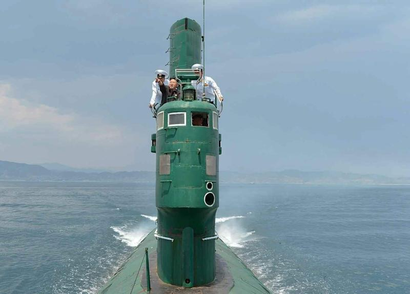 Kim Jong-un on board 'Submarine No 748' during a visit to the east coast North Korean Navy Unit 167 in a photo released in June 2014 - Credit: EPA/Rodong Sinmun