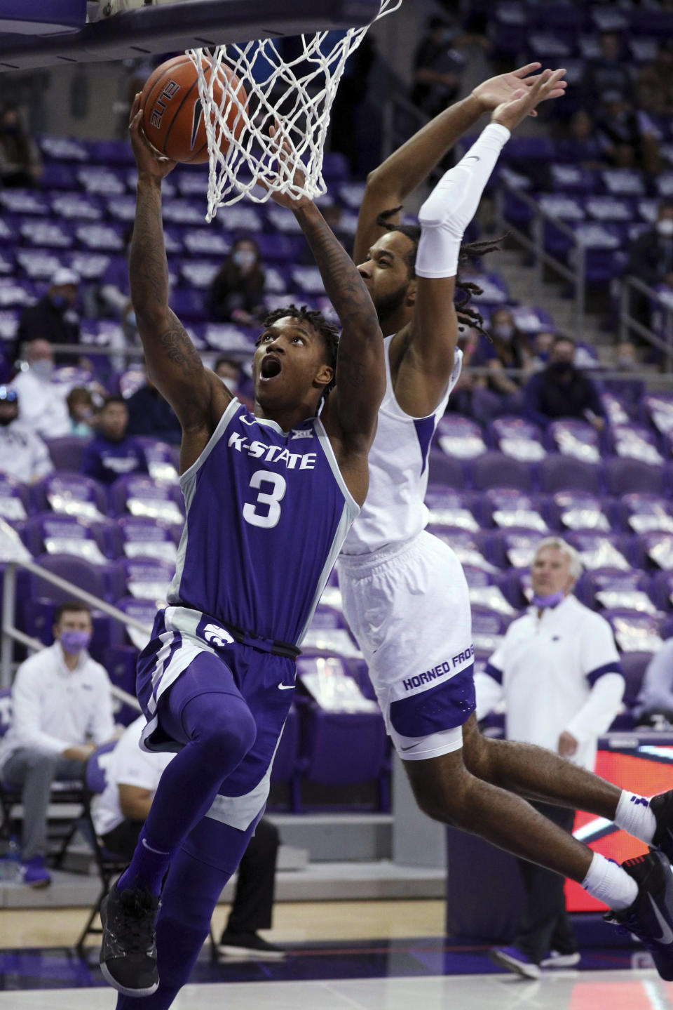 Kansas State guard DaJuan Gordon (3) goes up for a shot as TCU guard PJ Fuller (4) defends during the second half of an NCAA college basketball game Saturday, Feb. 20, 2021, in Fort Worth, Texas. (AP Photo/Richard W. Rodriguez)