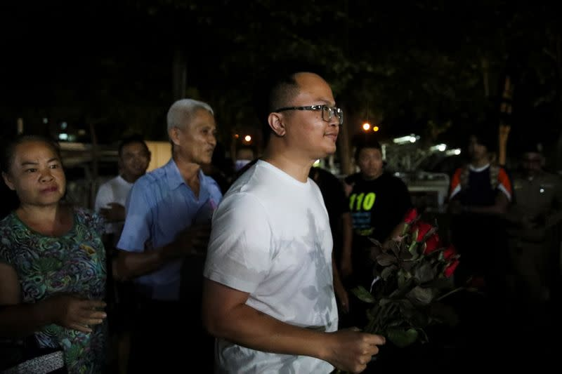 Human rights lawyer Anon Nampa, one of the leaders of recent anti-government protests, walks holding flowers after he released from Prison in Bangkok