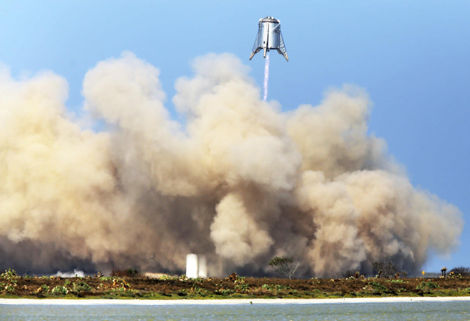 FILE - In this Tuesday, Aug. 27, 2019 file photo, SpaceX tests their StarHopper, successfully hovering 500 feet above the launch site and safely landing at the company's facility in Brownsville, Texas. (Miguel Roberts/The Brownsville Herald via AP)