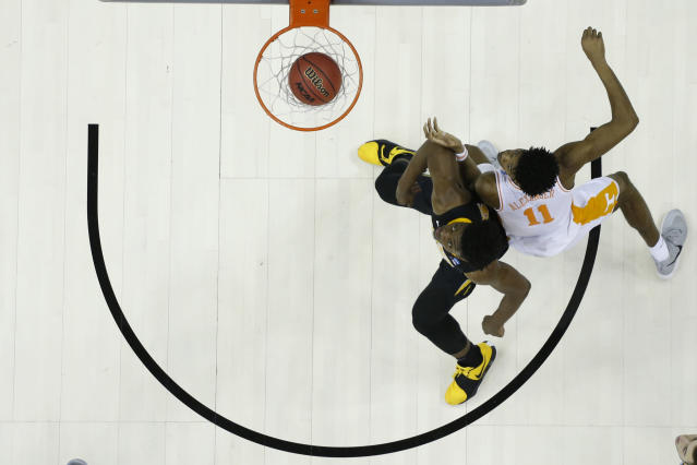 <p>Tyler Cook #25 of the Iowa Hawkeyes and Kyle Alexander #11 of the Tennessee Volunteers fight for a rebound in the second round of the 2019 NCAA Men's Basketball Tournament held at Nationwide Arena on March 24, 2019 in Columbus, Ohio. (Photo by Jamie Schwaberow/NCAA Photos via Getty Images) </p>