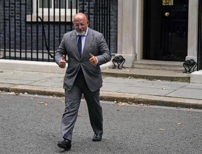 """Britain's Business minister Nadhim Zahawi gestures as he leaves 10 Downing Street, in London, Wednesday, Sept. 15, 2021. British Prime Minister Boris Johnson is shaking up his Cabinet as he attempts to move on from a series of political missteps and U-turns. Johnson's office said he would appoint """"a strong and united team to build back better from the pandemic."""" (AP Photo/Alberto Pezzali)"""