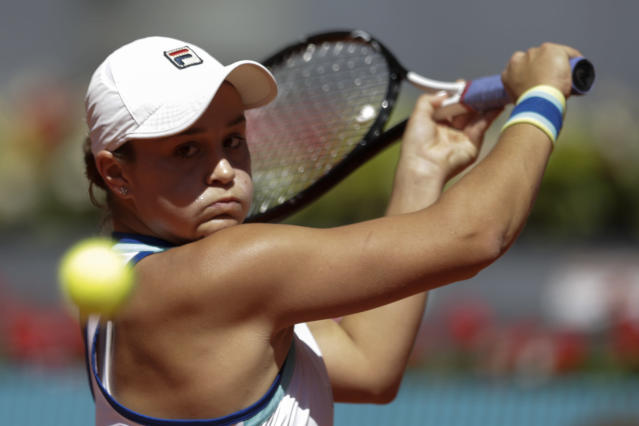 Ashleigh Barty of Australia, returns the ball to Simona Halep of Romania, at the Madrid Open tennis tournament in Madrid, Spain, Thursday, May 9, 2019. (AP Photo/Andrea Comas)