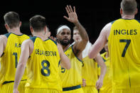 Australia's Patty Mills (5) celebrates with teammates during a men's basketball quarterfinal round game against Argentina at the 2020 Summer Olympics, Tuesday, Aug. 3, 2021, in Saitama, Japan. (AP Photo/Eric Gay)