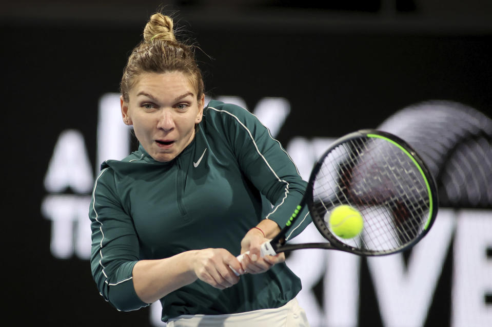 Romania's Simona Halep makes a backhand return to Australia's Ash Barty during an exhibition tennis event in Adelaide, Australia, Friday, Jan 29. 2021. (Kelly Barnes/AAP Image via AP)