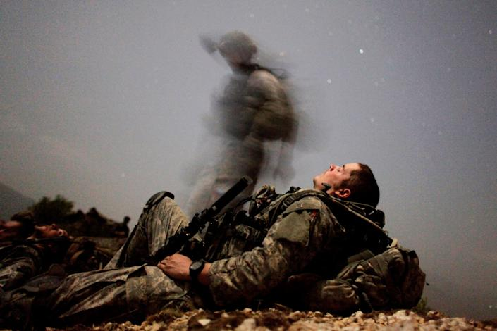 Image: A U.S. soldier takes a break during a night mission near Honaker Miracle camp at the Pesh valley of Kunar Province, Afghanistan. (Carlos Barria / Reuters file)