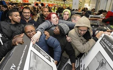 People fighting over TVs in Asda, Wembley on Black Friday 2013