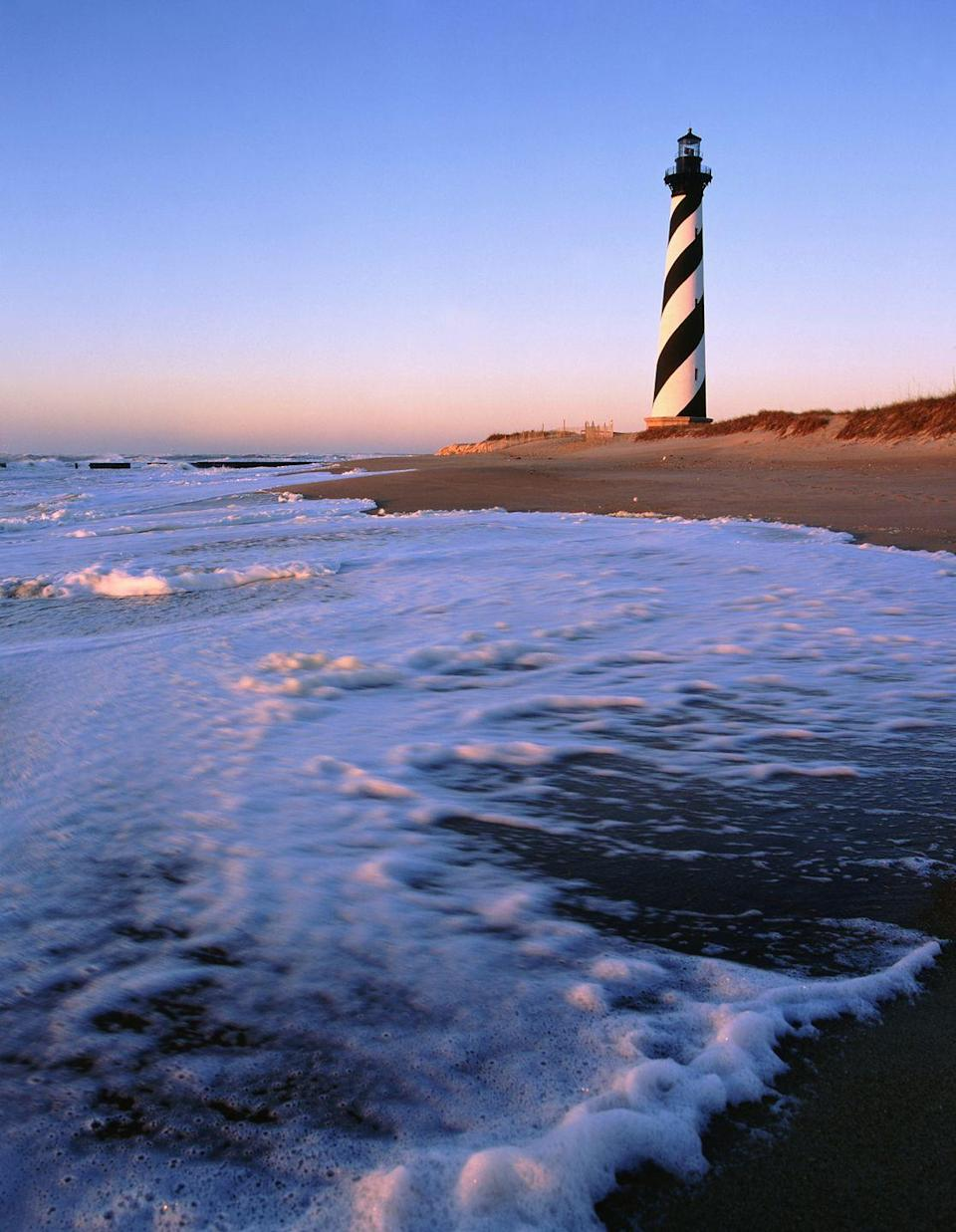 <p>The Cape Hatteras Lighthouse adds a spotlight to the beaches of Buxton, located at the tip of Hatteras Island.</p>