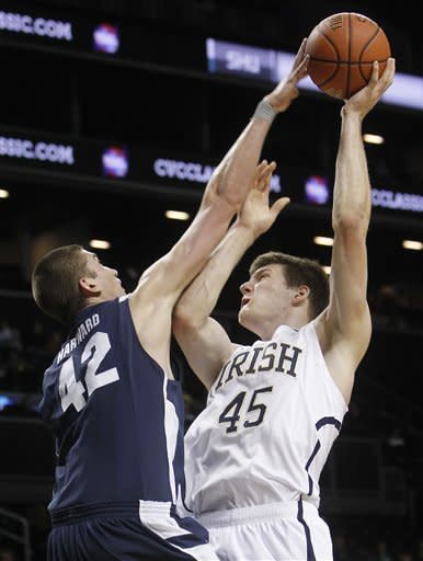Notre Dame's Jack Cooley (45) shoots against BYU's Ian Harward (42) during the first half of their NCAA college basketball game in the consolation round of the Coaches vs. Cancer Classic at the Barclays Center, Saturday, Nov. 17, 2012, in New York. (AP Photo/Jason DeCrow)