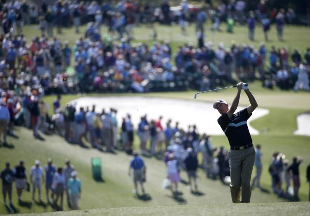 U.S. golfer Jim Furyk hits a shot on the first hole during the first round of the Masters golf tournament at the Augusta National Golf Club in Augusta, Georgia April 10, 2014. REUTERS/Mike Segar (UNITED STATES - Tags: SPORT GOLF)