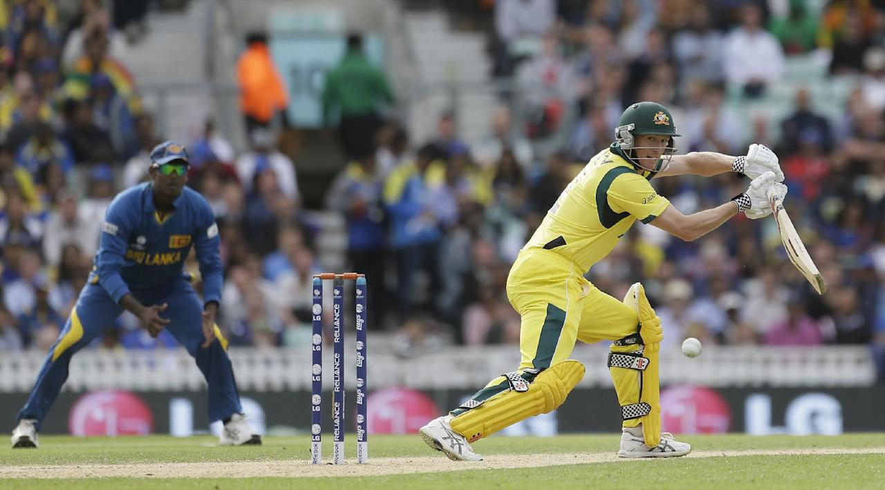 Australia's George Bailey, right, hits two runs off the bowling of Sri Lanka's Nuwan Kulasekera during their ICC Champions Trophy cricket match at the Oval cricket ground in London, Monday, June 17, 2013. (AP Photo/Alastair Grant)