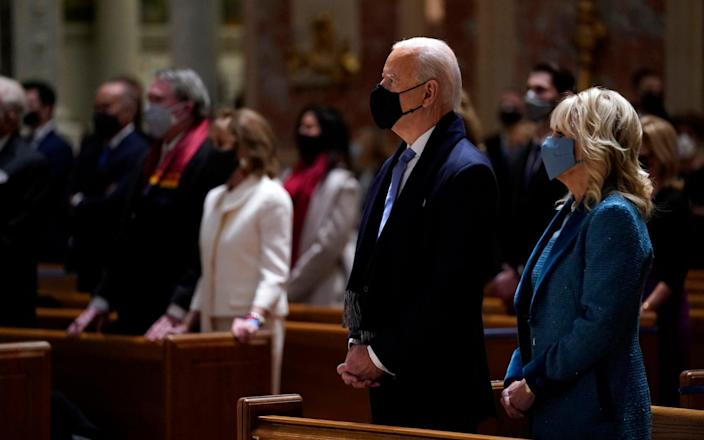 President-elect Joe Biden is joined his wife Jill Biden as they celebrate Mass at the Cathedral of St. Matthew the Apostle during Inauguration Day ceremonies - Evan Vucci/AP