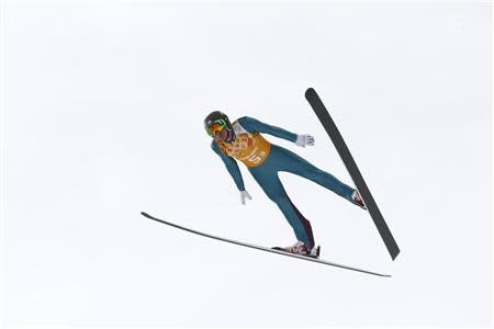 Bill Demong of the U.S. soars through the air during the trial round of the large hill ski jumping portion of the Nordic Combined team Gundersen event of the Sochi 2014 Winter Olympic Games, at the RusSki Gorki Ski Jumping Center in Rosa Khutor, February 20, 2014. REUTERS/Michael Dalder
