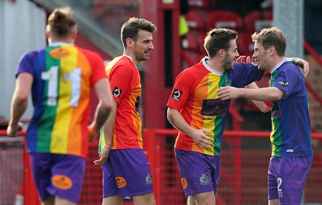 Altrincham players celebrate a goal scored by Josh Hancock (second from right) against Bradford AFC on Saturday. (Getty)
