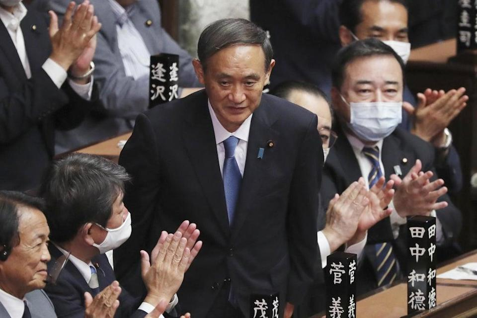 Yoshihide Suga, Japan's prime minister, has said he will not run for re-election as party leader (AP)