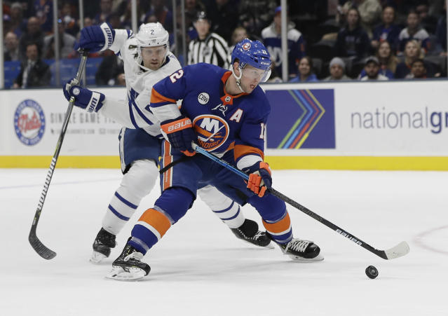 New York Islanders' Josh Bailey (12) drives past Toronto Maple Leafs' Ron Hainsey (2) during the second period of an NHL hockey game Monday, April 1, 2019, in Uniondale, N.Y. (AP Photo/Frank Franklin II)