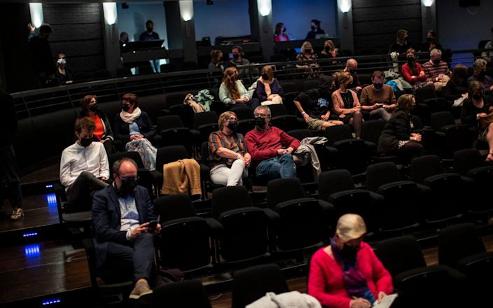 Socially-distanced theatregoers watch a performance of 'Jonathan' at the KVS theatre in Brussel - Francisco Seco/AP