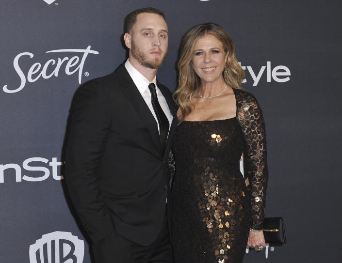 Chet Hanks, left, and Rita Wilson arrive at the InStyle and Warner Bros. Golden Globes afterparty at the Beverly Hilton Hotel on Sunday, Jan. 5, 2020, in Beverly Hills, Calif. (Richard Shotwell/Invision/AP)